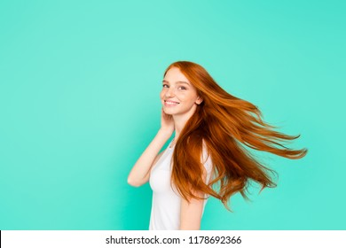 Profile side view photo of tenderness, tender, romantic, romance person look at camera isolated on shine teal background, hold hand near cheek turn and make hair light, airy