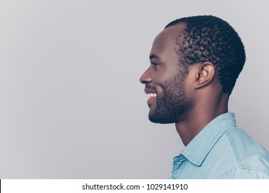 Profile, side view portrait with copy space, empty place for product of virile, smiling, manly, positive, cheerful man isolated on grey background