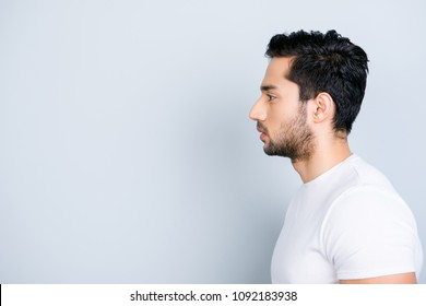 Profile side view portrait with copy space empty place for product of virile harsh macho in white outfit isolated on grey background wellness wellbeing daily care grooming concept