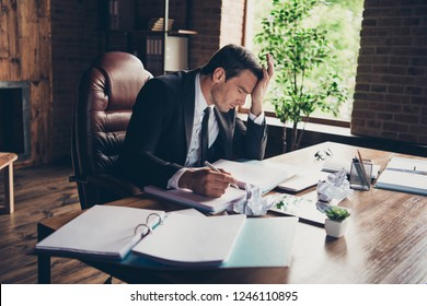 Profile side view portrait of elegant classy handsome sad man business shark ceo boss chief attorney lawyer writing article fail failure at work place station table desktop