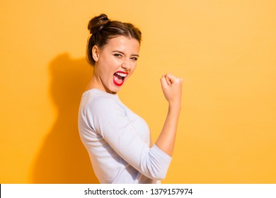 Profile side view portrait of her she nice cool attractive lovely winsome sweet cheerful cheery crazy girl breakthrough lucky isolated on bright vivid shine yellow background