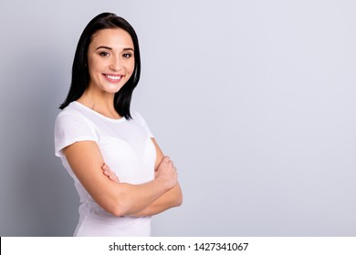 Profile side view portrait of her she nice-looking attractive lovely winsome lovable glad cheerful cheery girl folded arms isolated over light gray background