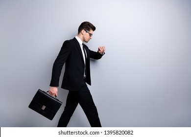 Profile side view portrait of his he nice classy chic attractive guy carrying diplomat marketing manager looking at minute late to office white collar shirt necktie isolated over light gray background