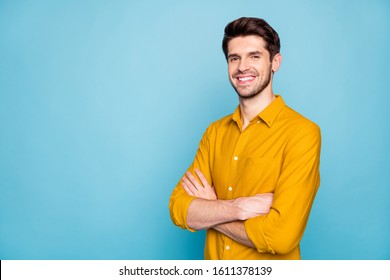 Profile side view portrait of his he nice attractive content cheerful cheery brown-haired guy folded arms isolated over bright vivid shine vibrant blue green turquoise color background - Shutterstock ID 1611378139