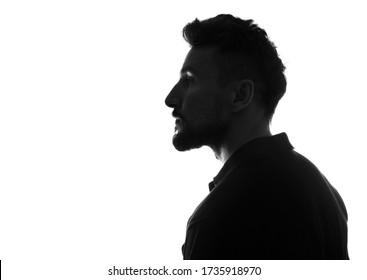 Profile  silhouette of male person over white