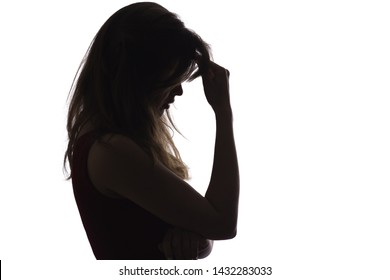 profile silhouette of a young upset woman, the girl leans her hand on her forehead and thinks about problems, the concept of difficult life situations, depression