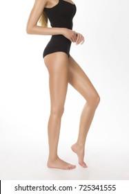 Profile of a slim woman's body, studio isolated shot
