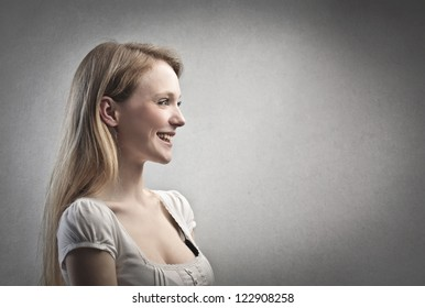 Profile of a smiling blonde girl