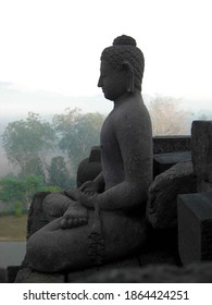 Profile of stone buddha statue sitting in meditation
