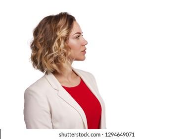 Profile of stylish positive woman wearing jacket looking forward, over white background