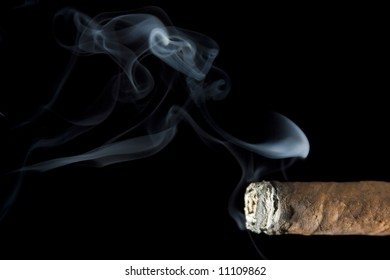 a profile of the tip of a cigar with smoke rising from it /