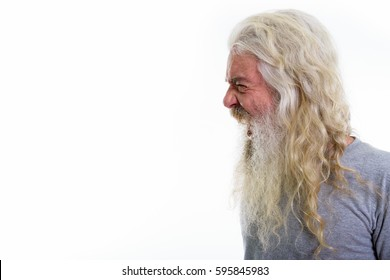 Profile view of angry senior bearded man looking furious while shouting