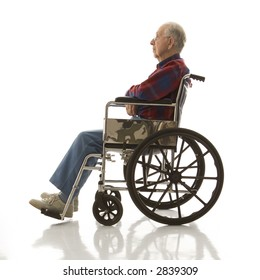 Profile view of Caucasion elderly man sitting in wheelchair.