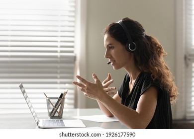 Profile view close up woman in headphones chatting online, using laptop, teacher leading lesson, recording webinar, explaining, teaching students, distance education, businesswoman consulting client