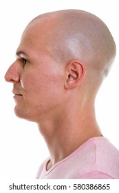 Profile view of face of young handsome bald man