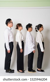 Profile view of group shot of Asian business people together