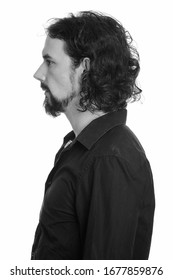 Profile view of handsome bearded businessman with curly hair