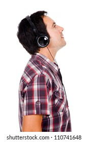 Profile view of a happy young man listening music. Isolated on white.