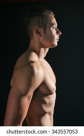 Profile view of muscular young man