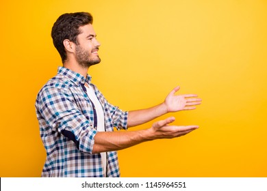 Profile view portrait of sales manager widely opened his hands and ready to accept a gift for the best employee of the month isolated on bright yellow background