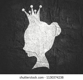 Profile view silhouette of a princess or queen. Cute adolescent girl portrait. Fashion branding emblem