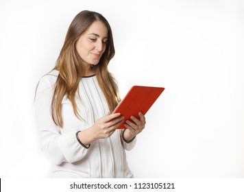 Profile view of woman reading on tablet, white background with text space
