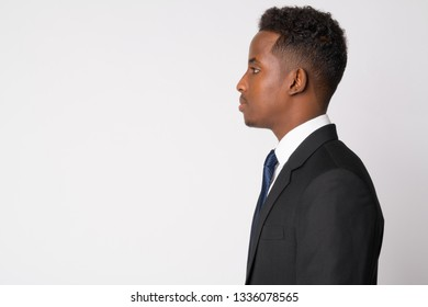Profile view of young African businessman in suit