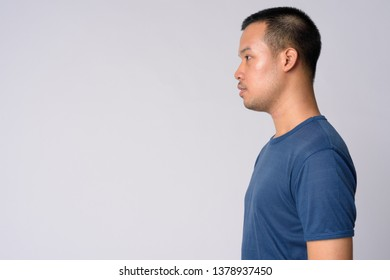 Profile view of young Asian man with short hair