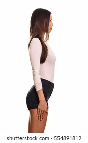 Profile view of young beautiful Brazilian woman standing isolated against white background