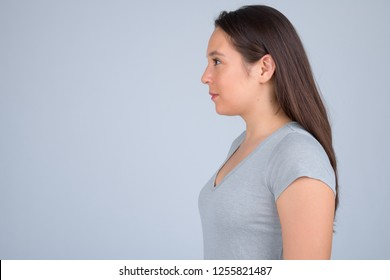 Profile view of young beautiful multi-ethnic woman against white background
