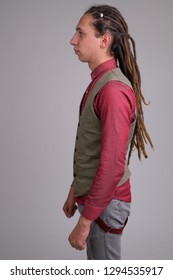 Profile view of young handsome businessman with dreadlocks