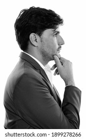 Profile view of young Persian businessman thinking
