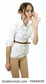 Profile view of a young woman gesturing a verbal call against white background