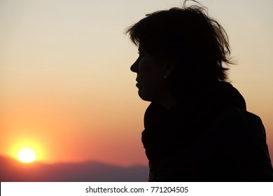 Profile woman in backlight at sunset