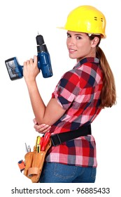 Profile of woman holding drill