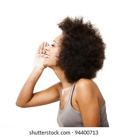 Profile of a young Afro-American woman calling someone, isolated on white