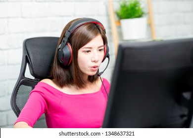 Profile of Young Asian Pro Gamer Girl Playing in Online Video Game