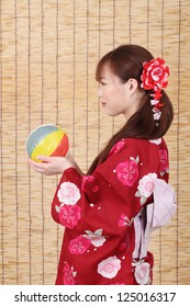 profile of young asian woman in traditional clothes of kimono with paper balloon