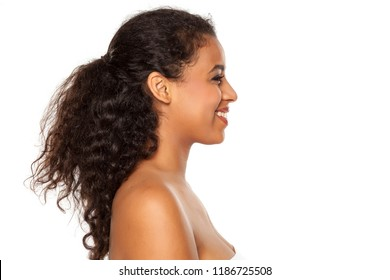 Profile of young beautiful dark-skinned woman on a white background