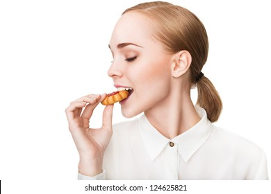 Profile of young beautiful healthy woman with cookie