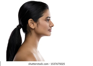 Profile  of young and beautiful Indian woman isolated on white background