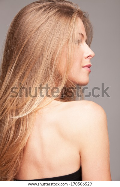 profile of young  blond woman