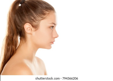 profile of young girl without makeup on white background