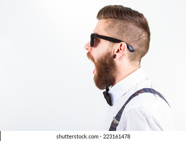 profile  of a young hipster man wearing elegant clothes and eyeglasses with open mouth