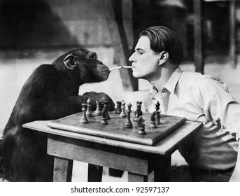 Profile of a young man and a chimpanzee smoking cigarettes and playing chess