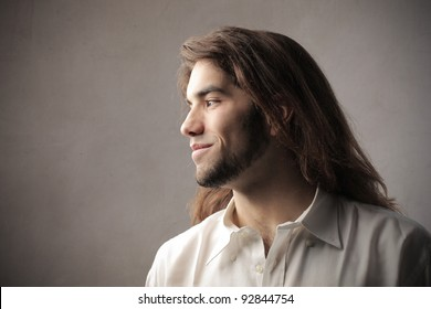 Profile of a young man with long hair