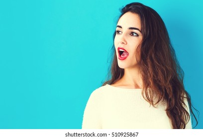Profile of a young woman on a blue background