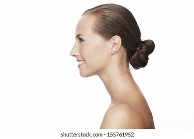 Profile of young woman smiling against white background