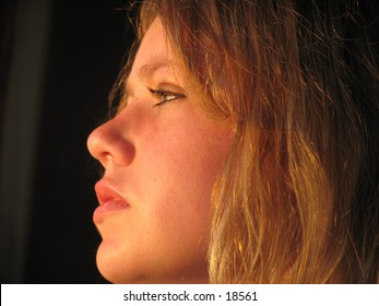 profile of a young woman's sunlit face