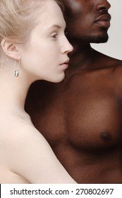 Profiles of young beautiful white girl and a handsome african man